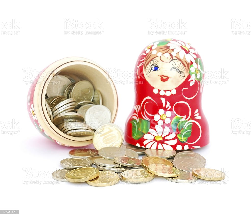 Russian doll with coins royalty-free stock photo