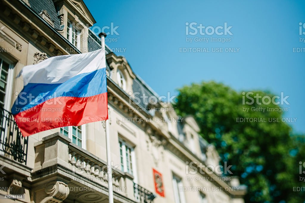 Russian Federation flag waving in front of Consulate of Russia stock photo