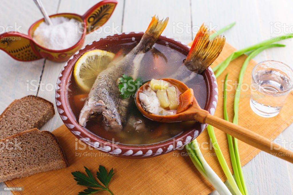 Russian fish soup on rustic background stock photo