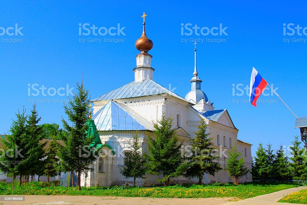 Russian flag and church in Suzdal central square, Golden Ring stock photo