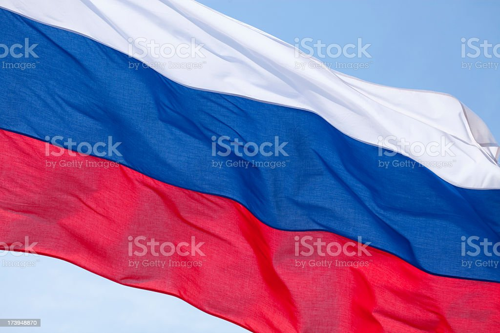 Russian flag fluttering in the wind stock photo