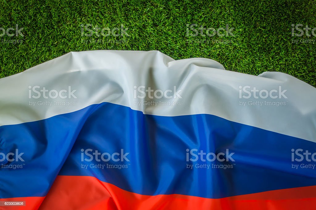 Russian flag on green grass stock photo