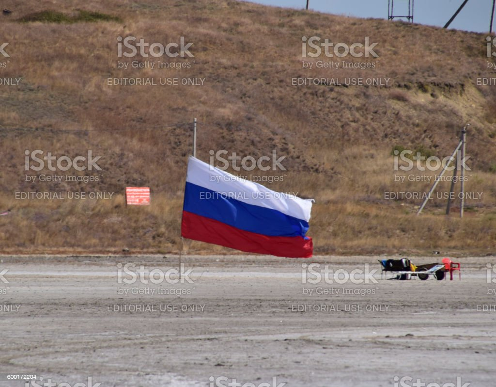 Russian flag on the bottom of a salty lake stock photo