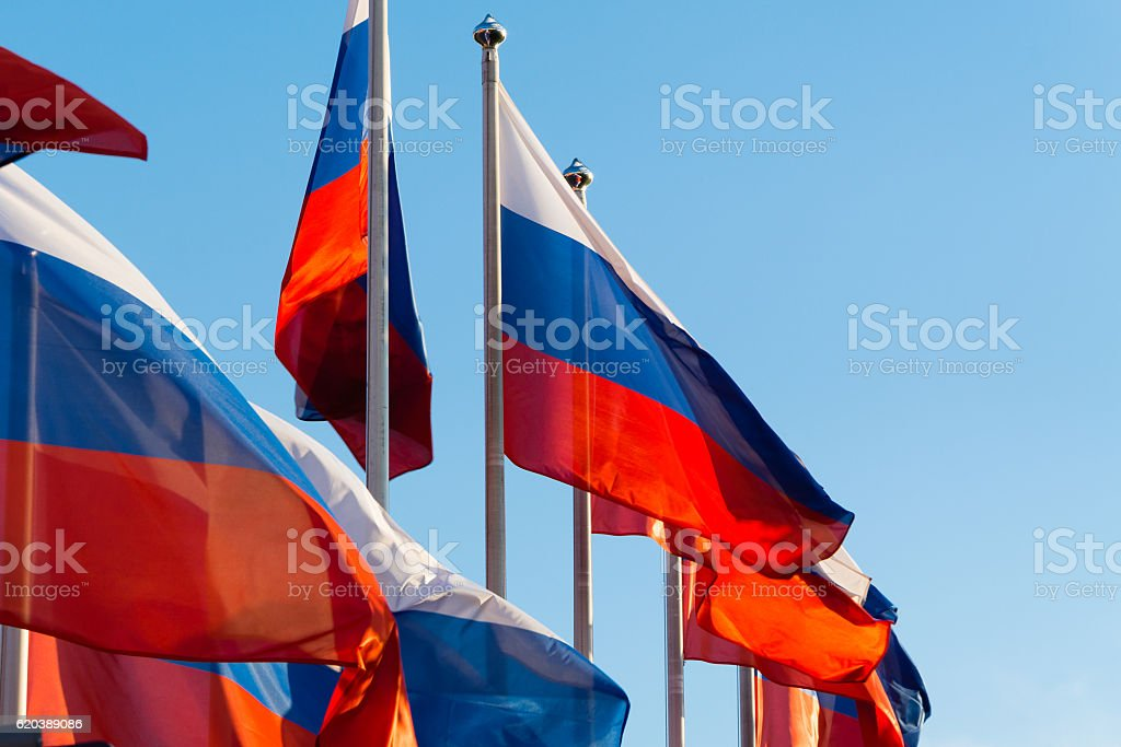 Russian flags with blue sky stock photo