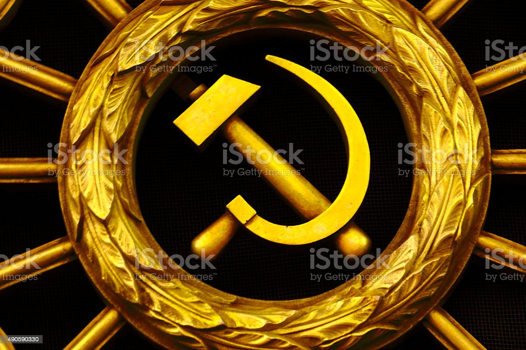 Russian gold Hammer and Sickle, Soviet Union symbol stock photo