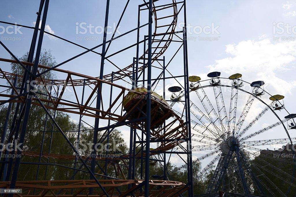 'Russian hills' amusement ride and ferris wheel royalty-free stock photo