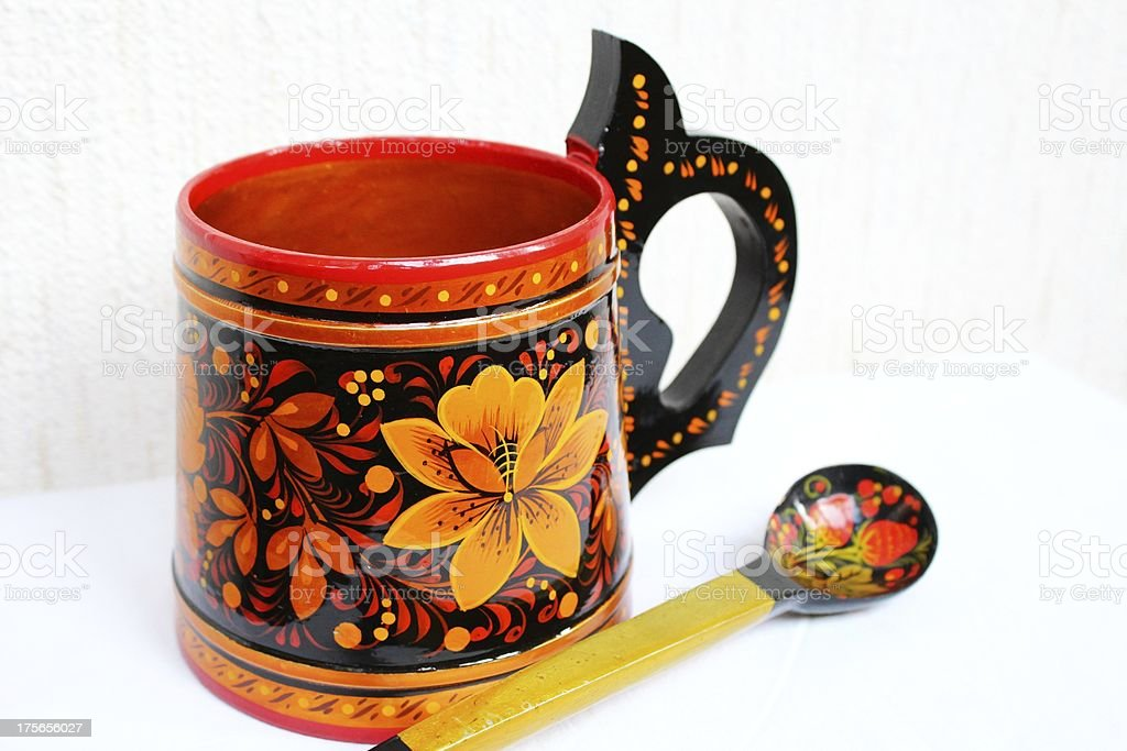 Russian Khokhloma wooden cup with a spoon royalty-free stock photo