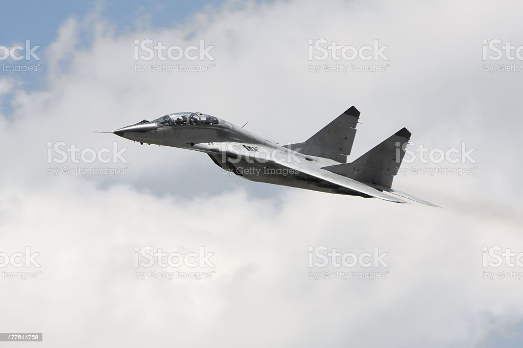 Russian military fighter jet MIG 29 in flight stock photo