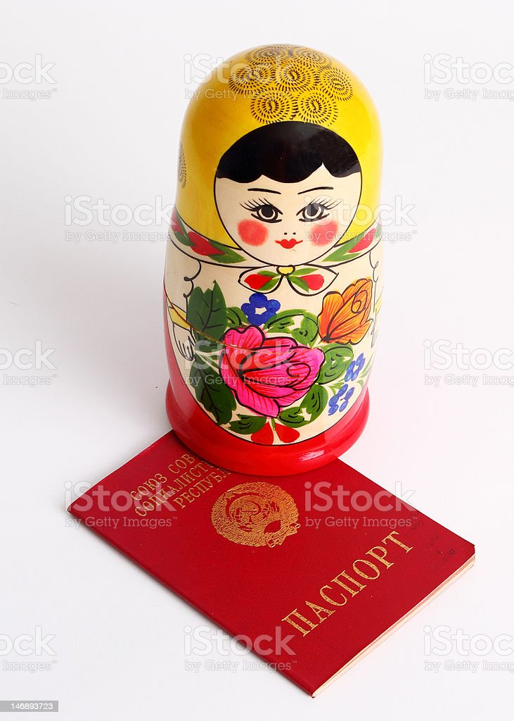 Russian Nesting Doll standing on Soviet Union USSR Passport royalty-free stock photo