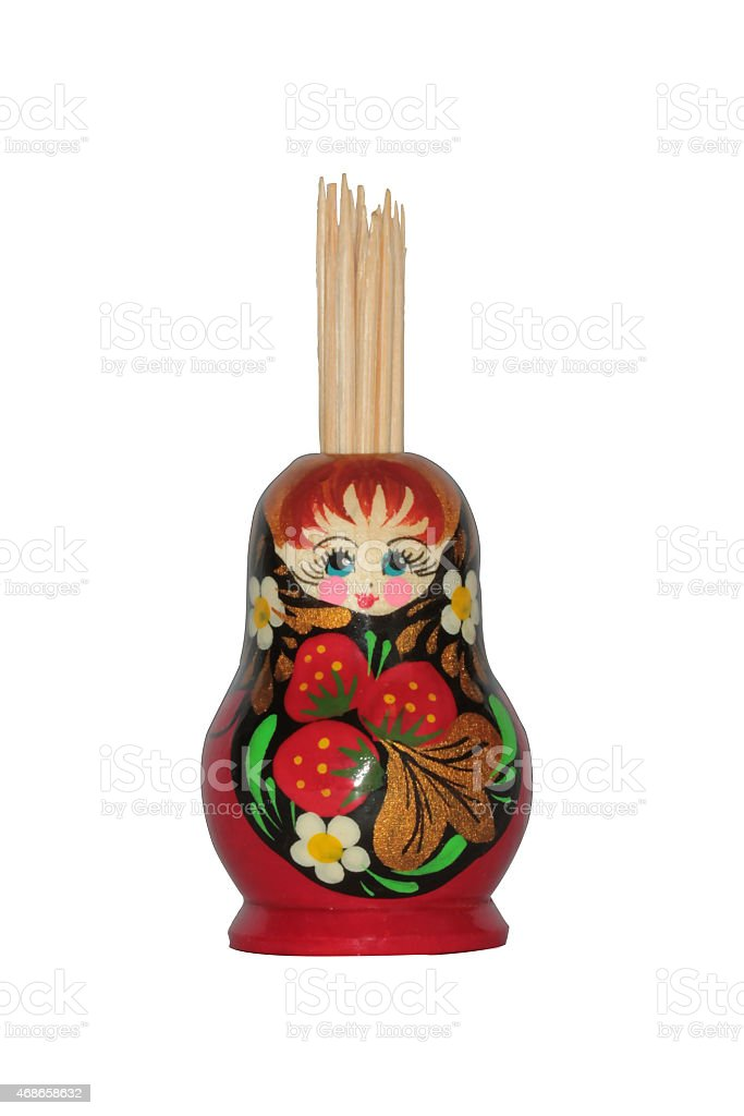 Russian nesting doll with toothpicks isolated stock photo