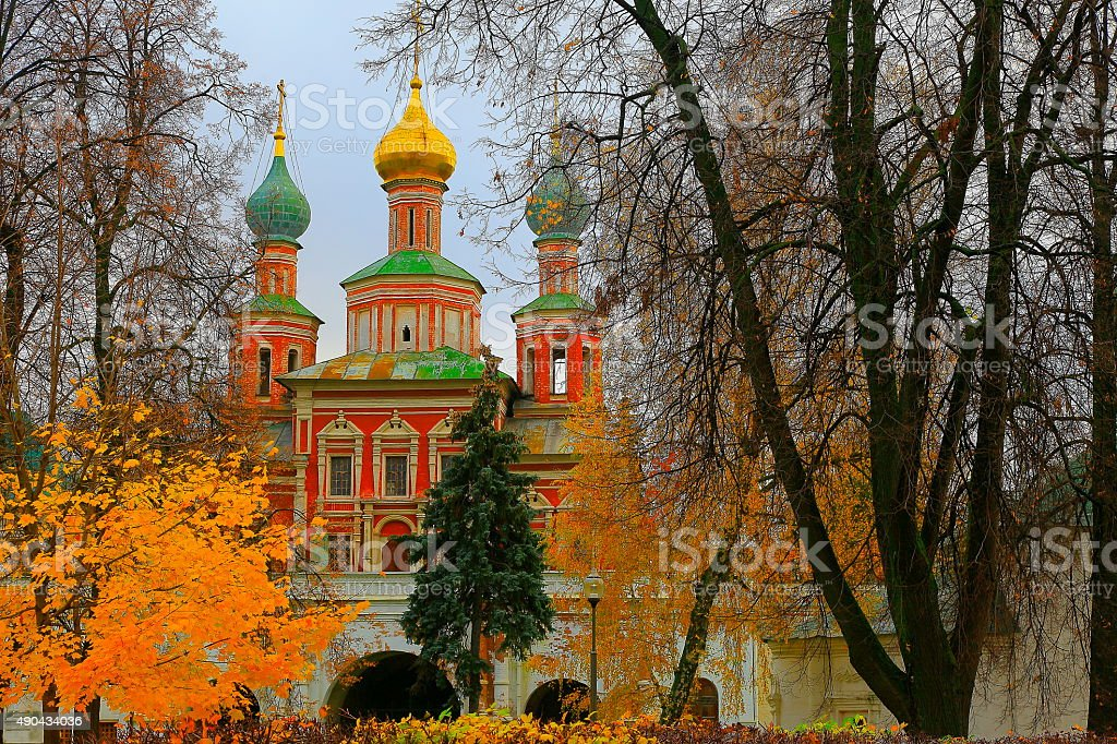 Russian Novodevichy Convent Monastery church, dramatic autumn sunset, Moscow stock photo