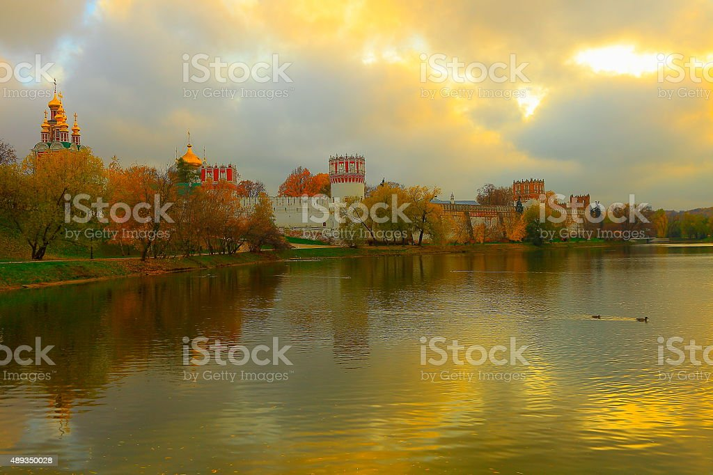 Russian Novodevichy Convent Monastery dramatic autumn sunset, Moscow stock photo