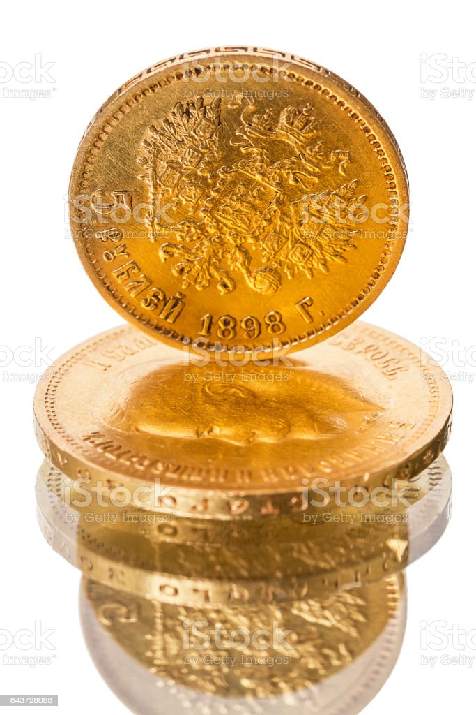 Russian old coin of pure gold on white stock photo
