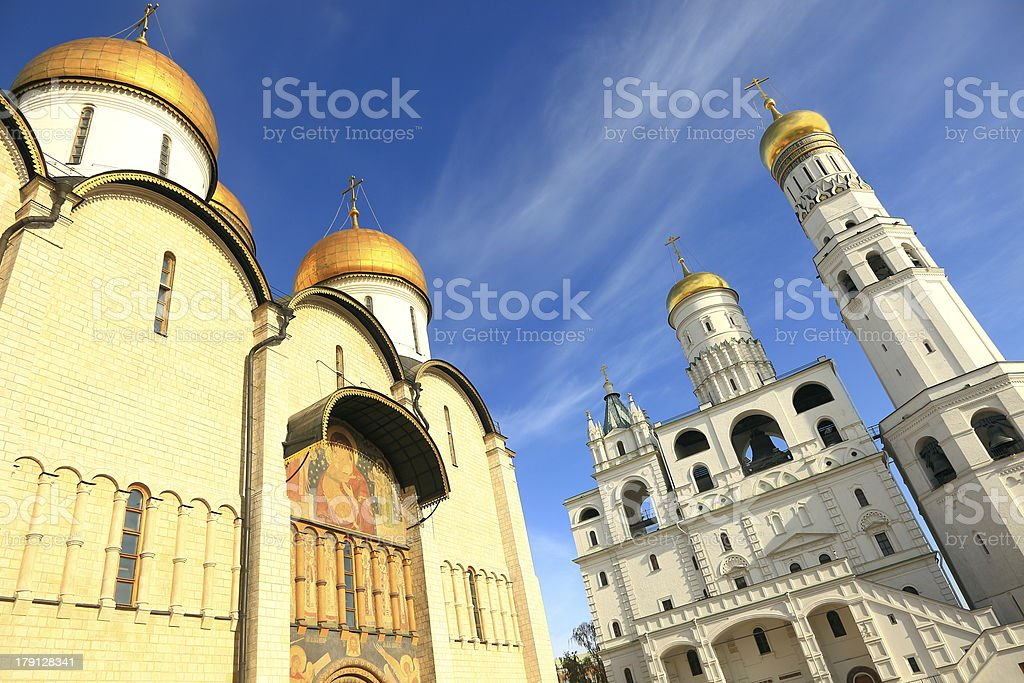 Russian onion domes in Kremlin and blue sky - Moscow stock photo