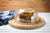 Russian pancakes - blini - under glass bowl