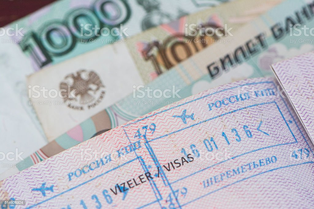 Russian Passport Stamp and Rubles stock photo