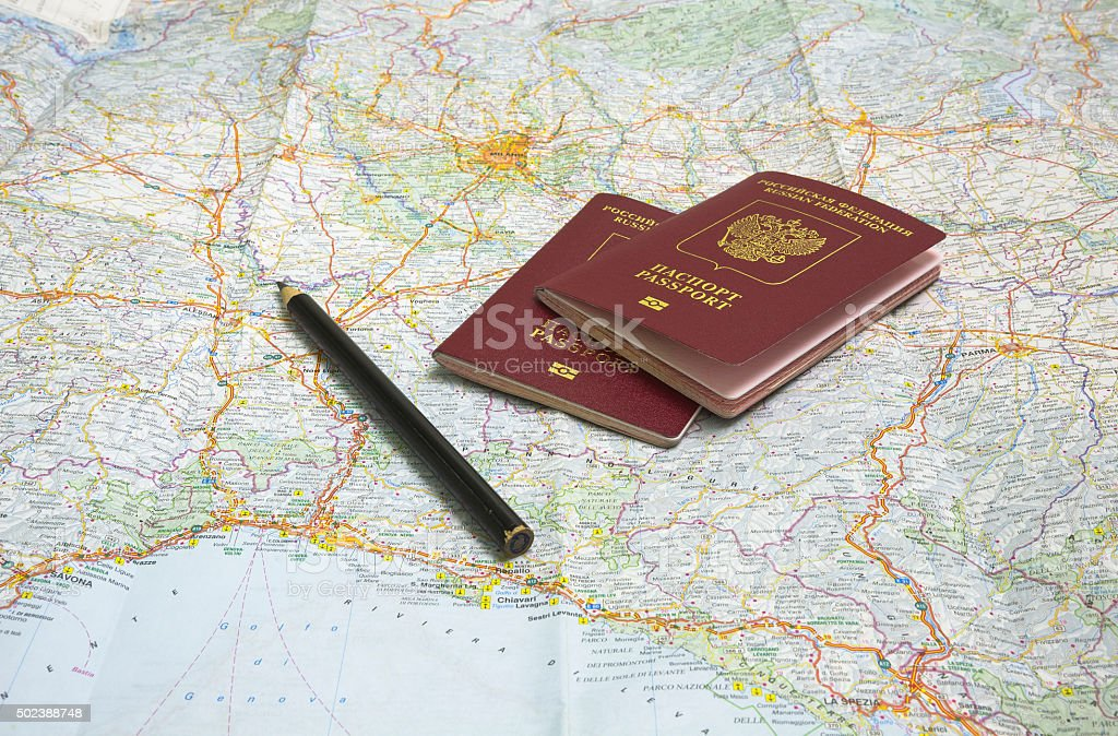 Russian passports and pencil on a map of Europe stock photo