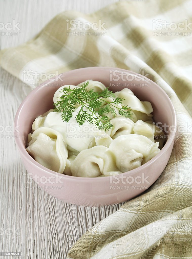 Russian pelmeni with sour cream royalty-free stock photo