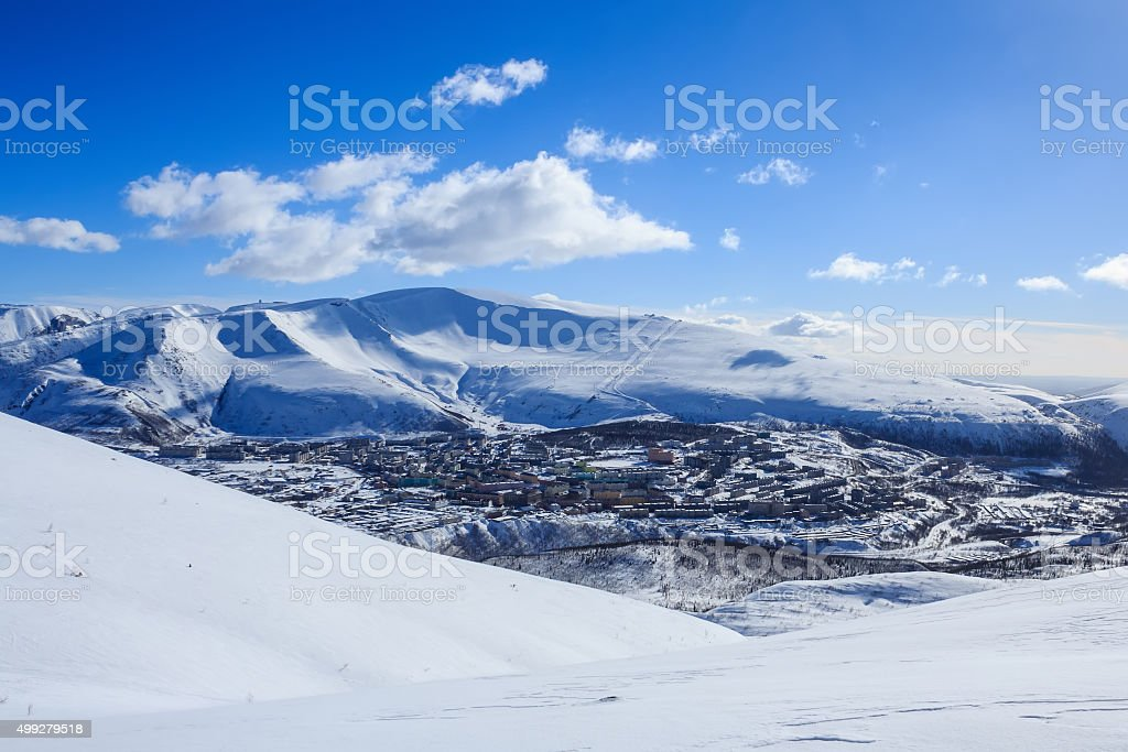 russian polar city with panel houses in winter Khibiny mountains stock photo