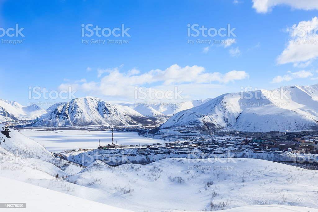 russian polar industrial city frozen lake in winter Khibiny mountains stock photo
