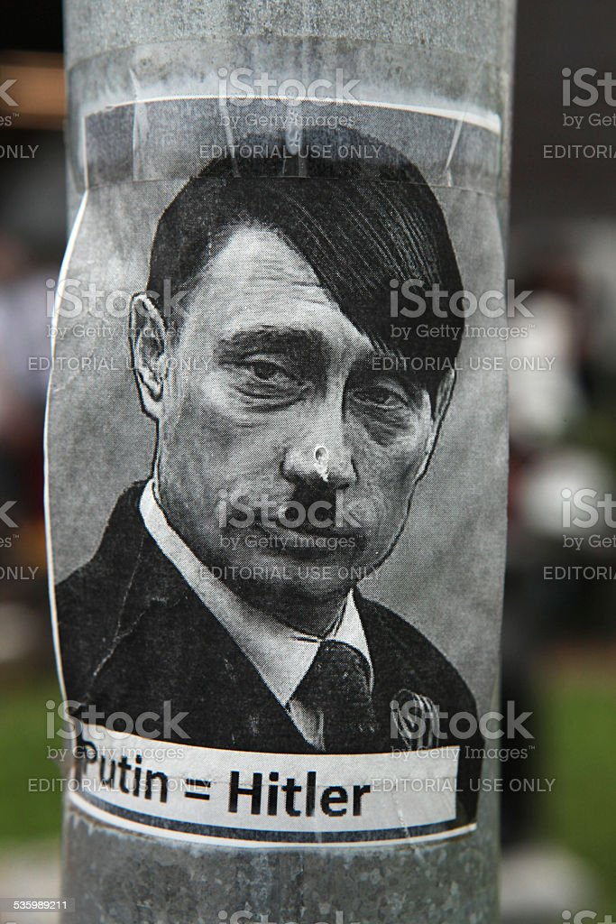 Russian president Vladimir Putin depicted as Adolf Hitler stock photo