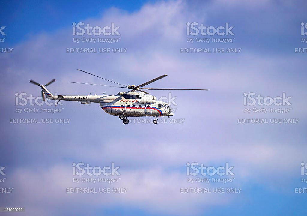 Russian president`s helicopter in the cloudy skies stock photo