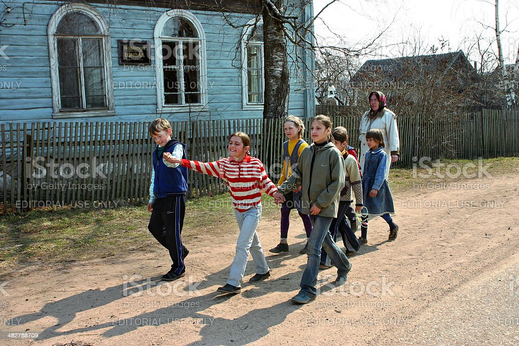 Russian pupils of rural schools, walk outdoors stock photo