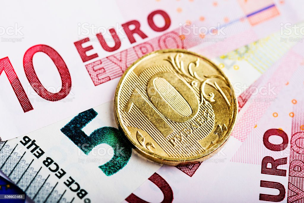 russian rubles coin on the European banknotes (five and ten) stock photo