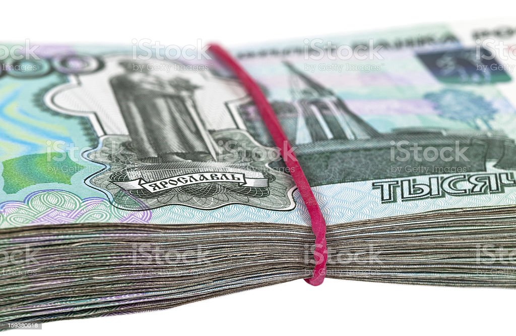Russian rubles wrapped by rubber on white background royalty-free stock photo