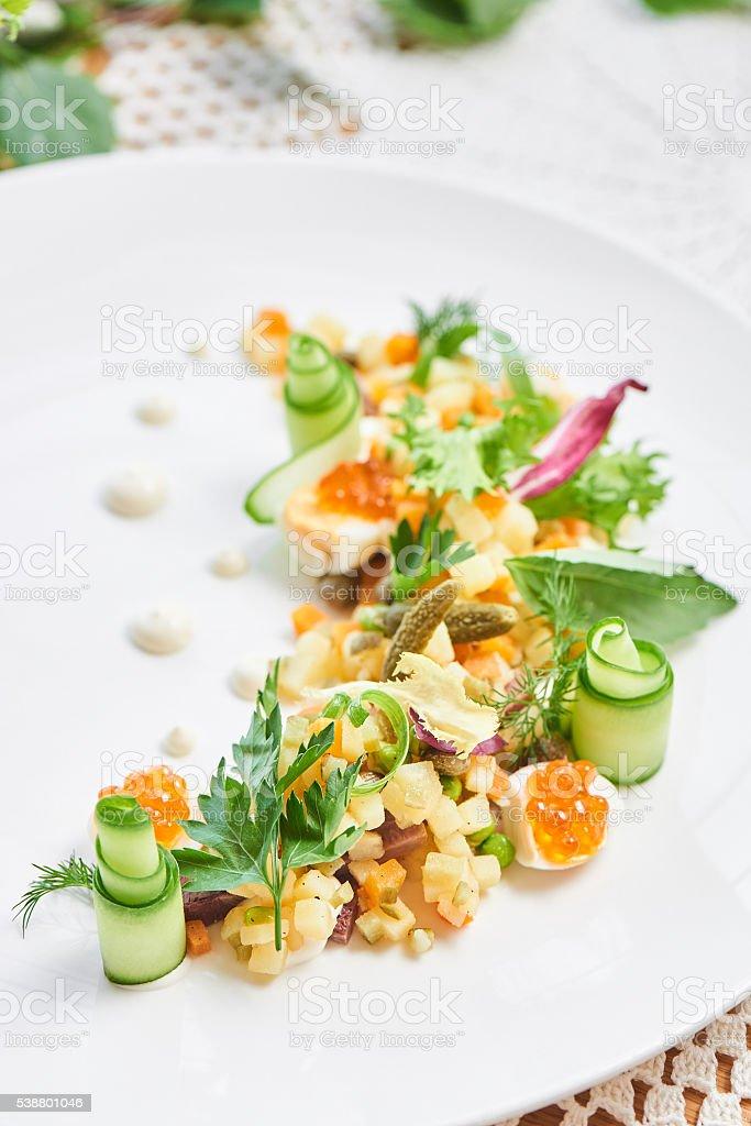 Russian salad white plate stock photo