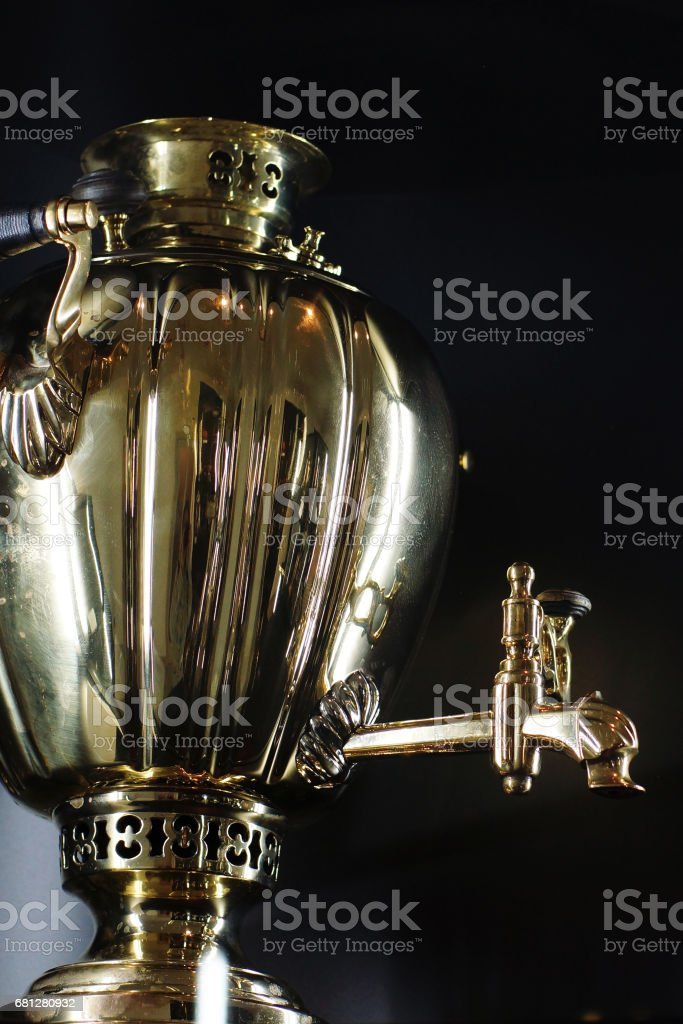 Russian samovar, device for water heating, gold and polished, vertical stock photo
