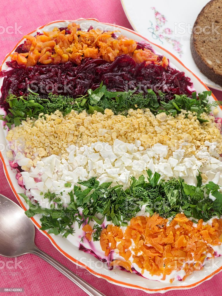 Russian Shuba Salad with Beetroot, Potatoes, Carrots and Herring royalty-free stock photo
