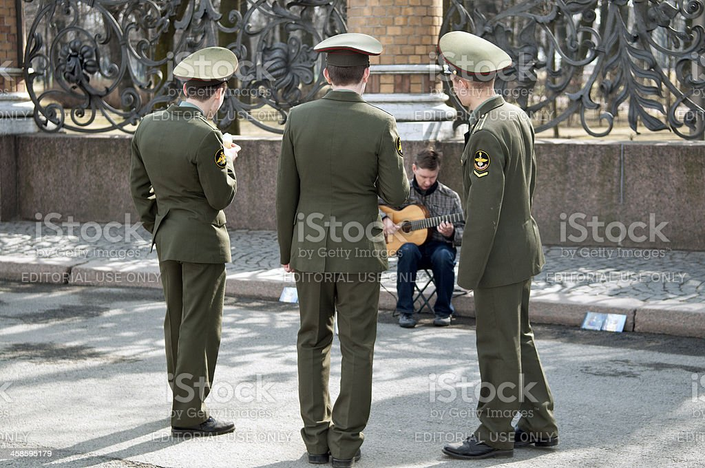 Russian Soldiers Listening to the Music royalty-free stock photo