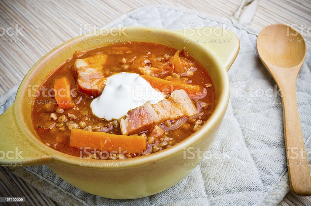 Russian soup shchi with bacon and buckwheat royalty-free stock photo