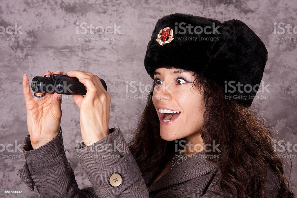 Russian spy looking through binoculars royalty-free stock photo