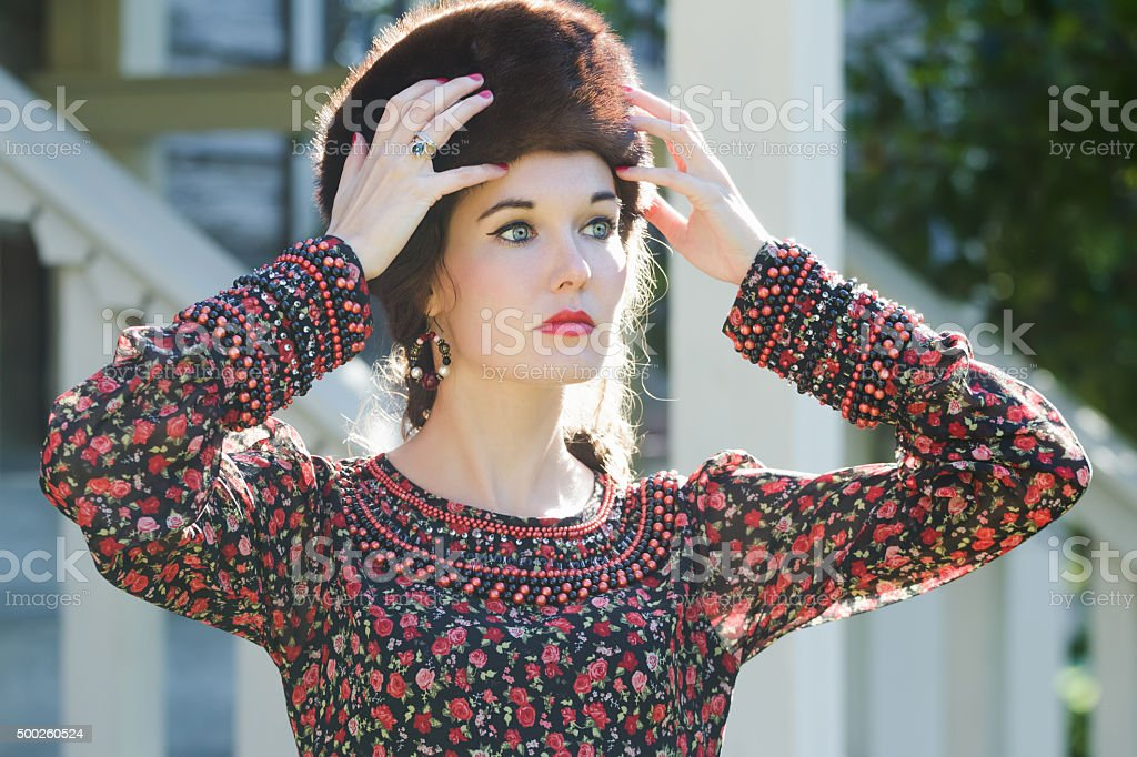 Russian style beauty wearing fur Cossack hat and silver ring stock photo