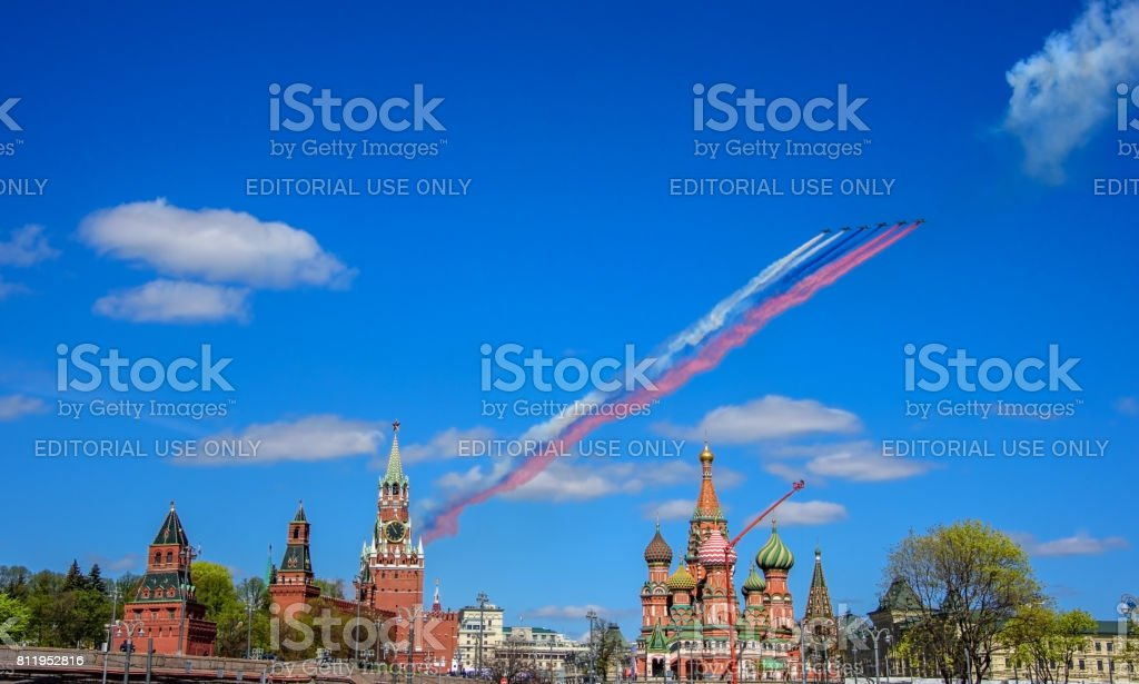 Russian Su-25 assault aircrafts leaving smoke as tricolor Russian flag at the rehearsal for the Victory Day military parade stock photo