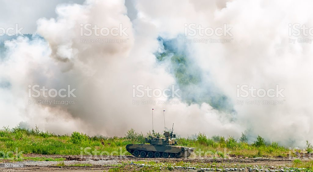 Russian tank T-80 making smoke screen from enemy stock photo