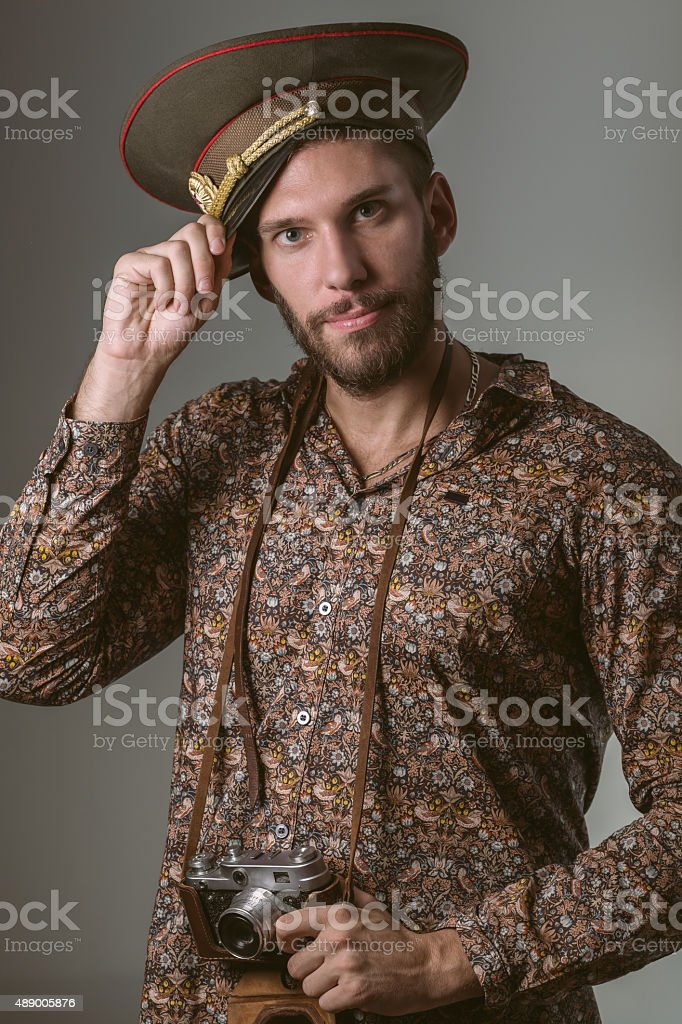Russian Tourist Wearing Military Hat and Camera royalty-free stock photo