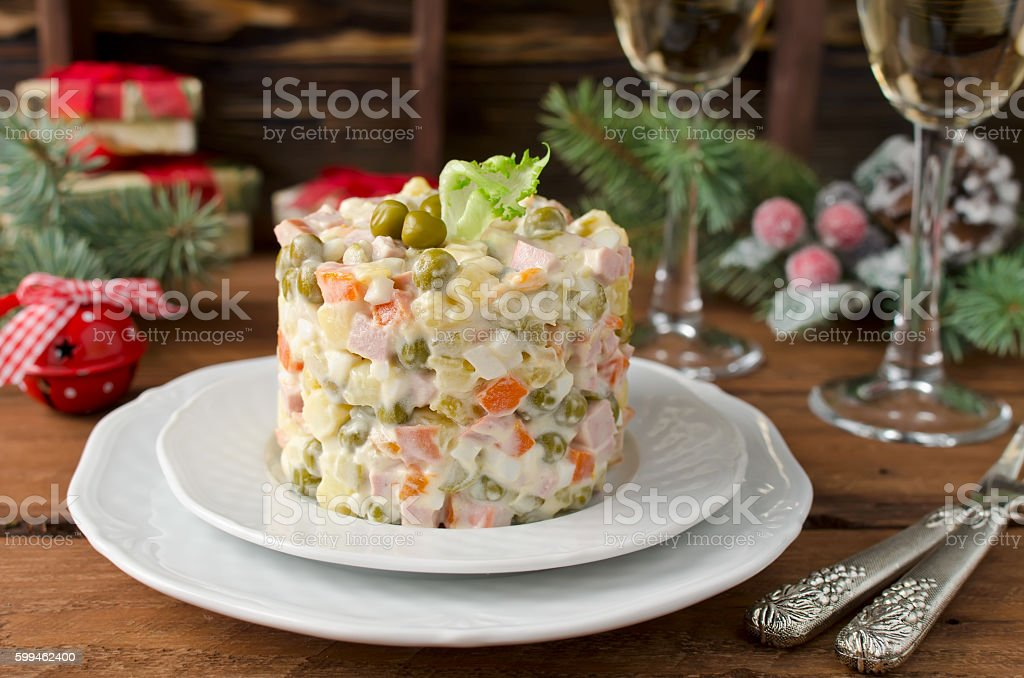 Russian traditional salad Olivier with vegetables and meat stock photo
