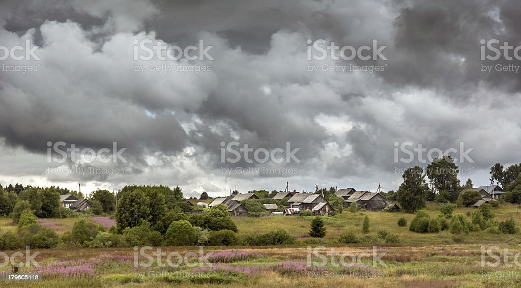 Russian village before storm royalty-free stock photo