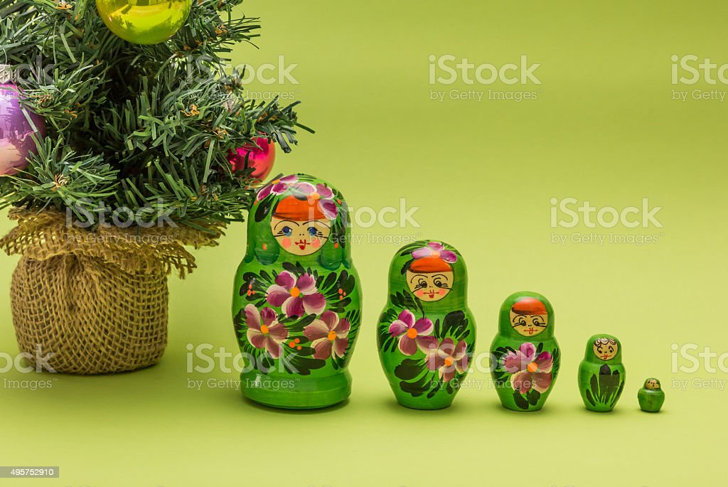 Russian wooden dolls and a Christmas tree stock photo