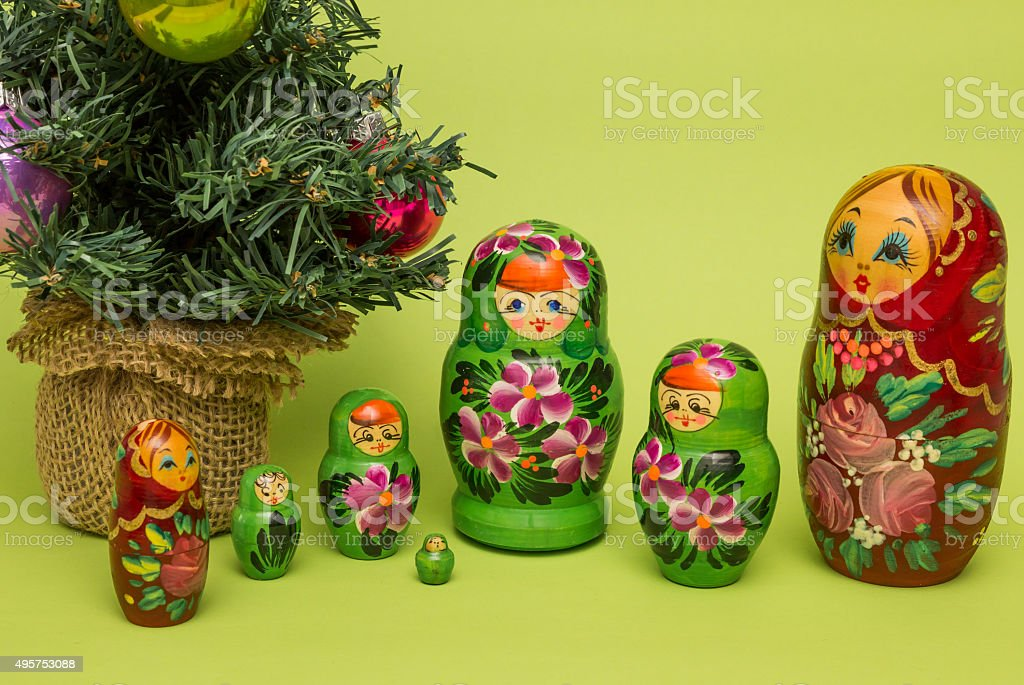 Russian wooden dolls around a Christmas tree stock photo