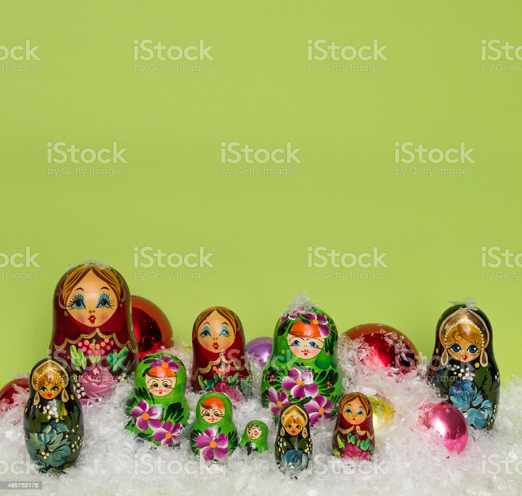 Russian wooden dolls with snow and Christmas balls stock photo