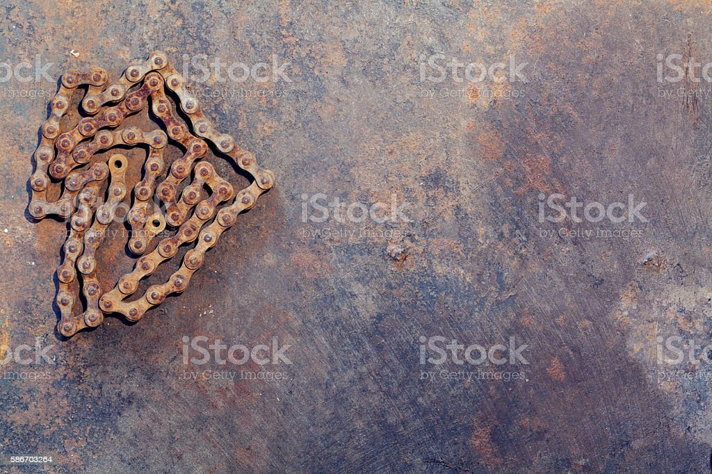Rust chain on metal work bench stock photo