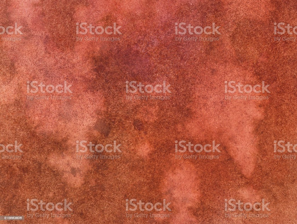 Rust colored background with mottled texture on paper stock photo
