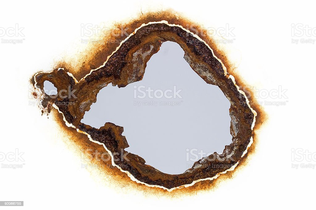 Rust hole royalty-free stock photo
