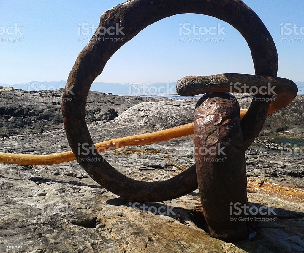 rusted anchor point on beach stock photo