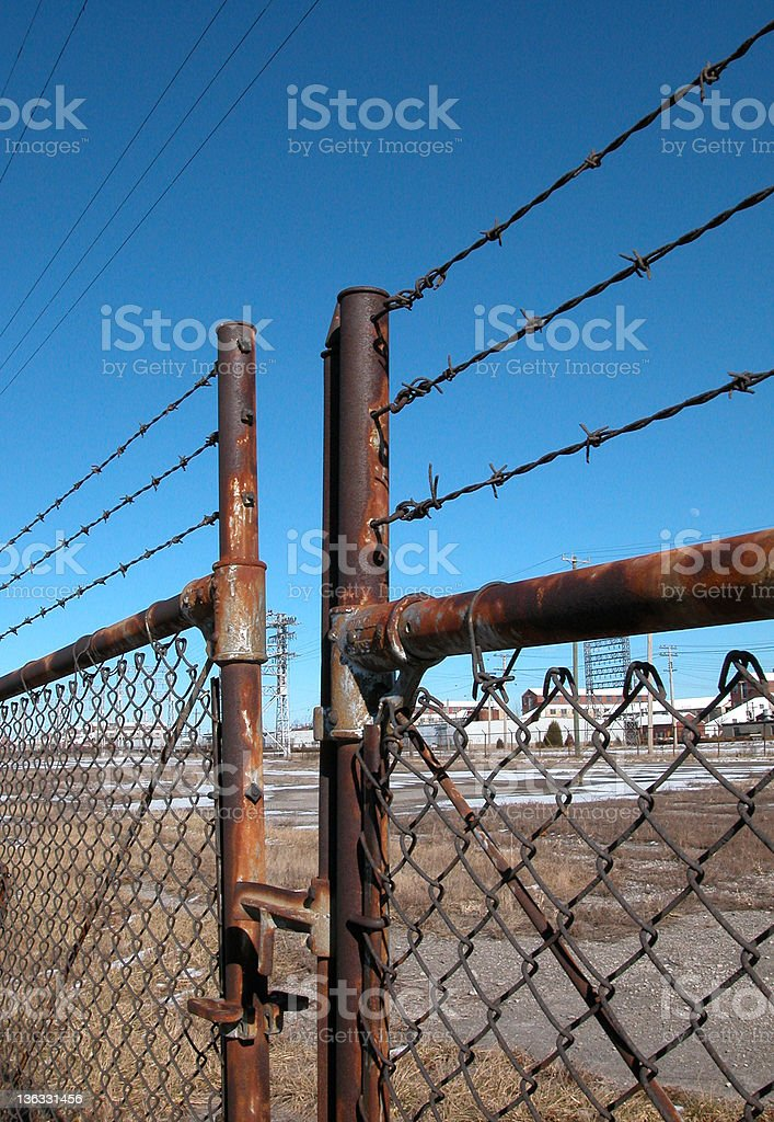 Rusted barbed-wire gate royalty-free stock photo