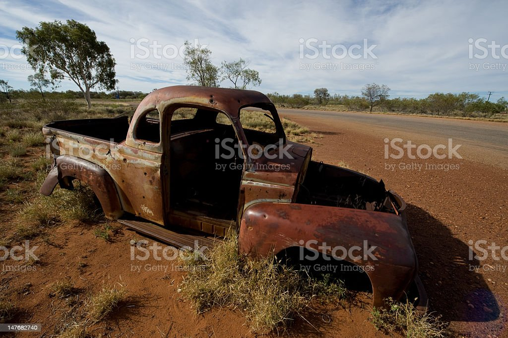 rusted car wreck stock photo
